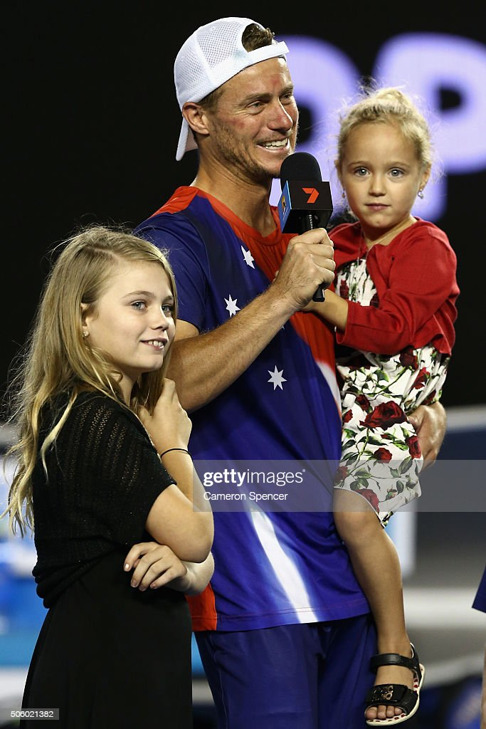 Lleyton Hewitt of Australia is interviewed on court with his children after losing his second round match against David Ferrer of Spain during day four of the 2016 Australian Open at Melbourne Park on January 21, 2016 in Melbourne, Australia.