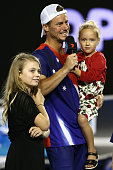 Lleyton Hewitt of Australia is interviewed on court with his children after losing his second round match against David Ferrer of Spain during day...