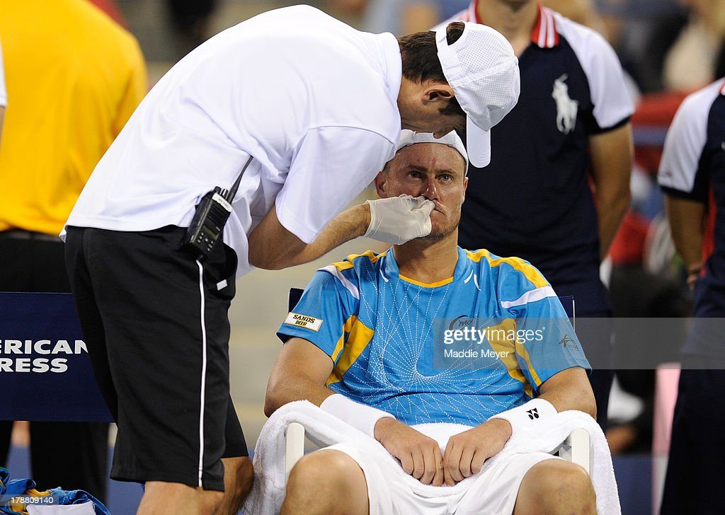 Lleyton Hewitt of Australia is tended to between points against Juan Martin Del Potro of Argentina during their round match on Day Five of the 2013 US Open at USTA Billie Jean King National Tennis Center on August 30, 2013 in the Flushing neighborhood of the Queens borough of New York City.