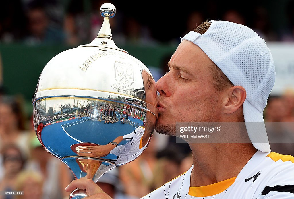 Lleyton Hewitt of Australia kisses the trophy after defeating Juan Martin Del Potro of Argentina in the final of the Kooyong Classic in Melbourne on January 12, 2013. AFP PHOTO/William WEST USE