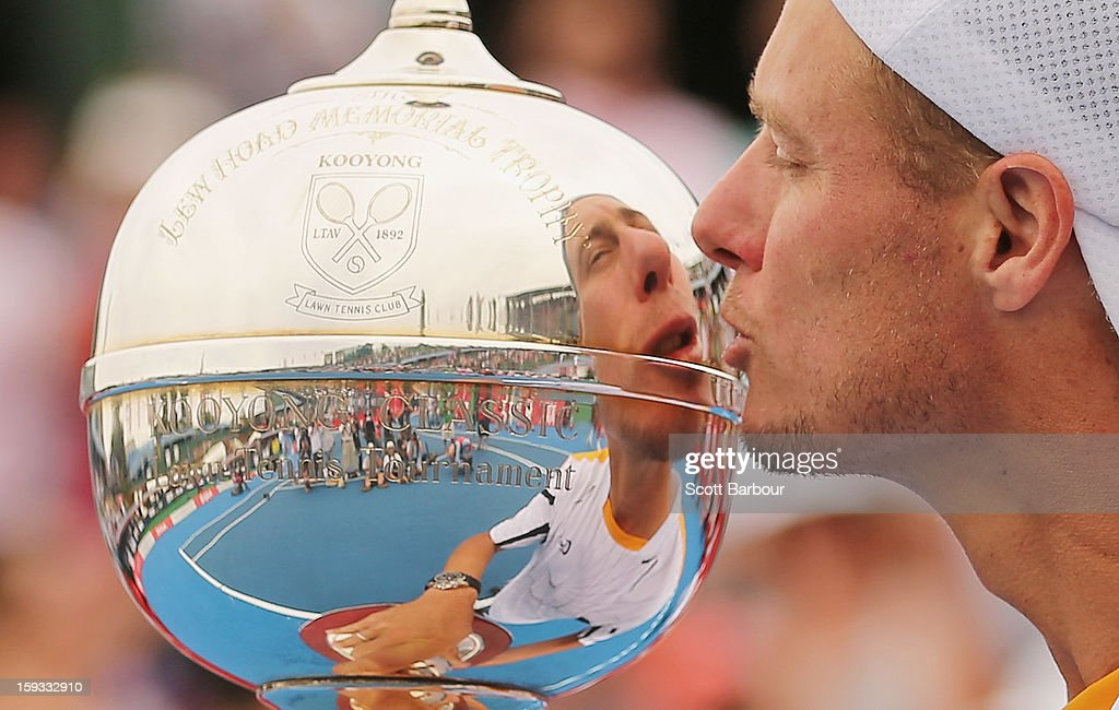 Lleyton Hewitt of Australia kisses the winners trophy after winning his match against Juan Martín del Potro of Argentina during day four of the AAMI Classic at Kooyong on January 12, 2013 in Melbourne, Australia.