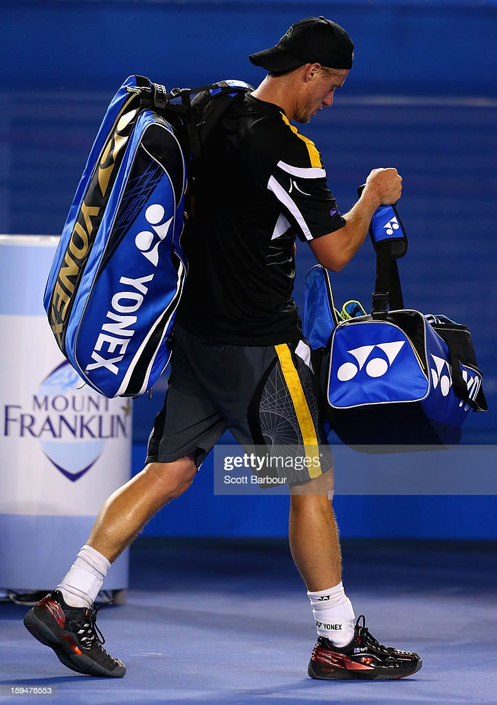 Lleyton Hewitt of Australia leaves the court after losing his first round match against Janko Tipsarevic of Serbia during day one of the 2013 Australian Open at Melbourne Park on January 14, 2013 in Melbourne, Australia.