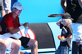 Lleyton Hewitt of Australia looks at his son Cruz Hewitt during his training session ahead of the 2014 Australian Open at Melbourne Park on January 9...