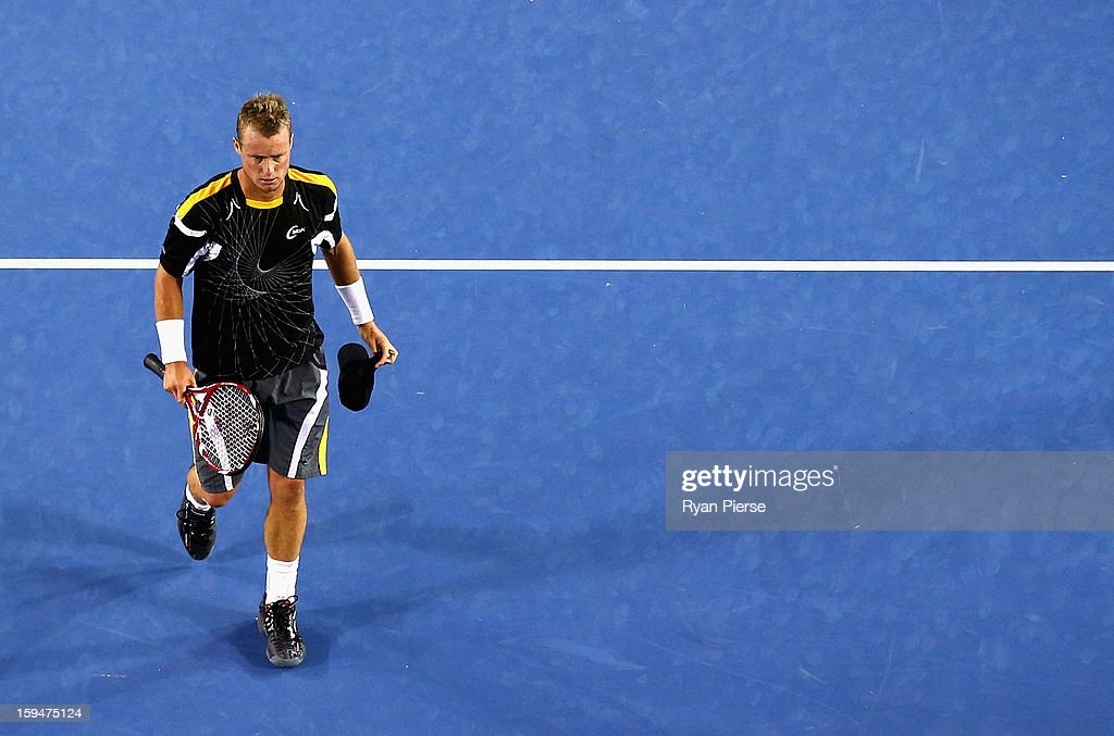 Lleyton Hewitt of Australia looks dejected after losing his first round match against Janko Tipsarevic of Serbia during day one of the 2013 Australian Open at Melbourne Park on January 14, 2013 in Melbourne, Australia.
