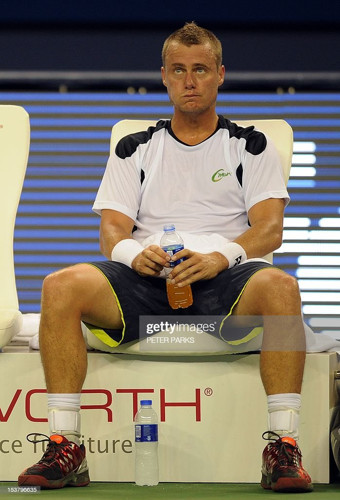 Lleyton Hewitt of Australia looks on during a break in his match against Radek Stepanek of the Czech Republic in the first round of the Shanghai Masters tennis tournament in Shanghai, on October 9, 2012. AFP PHOTO / Peter PARKS