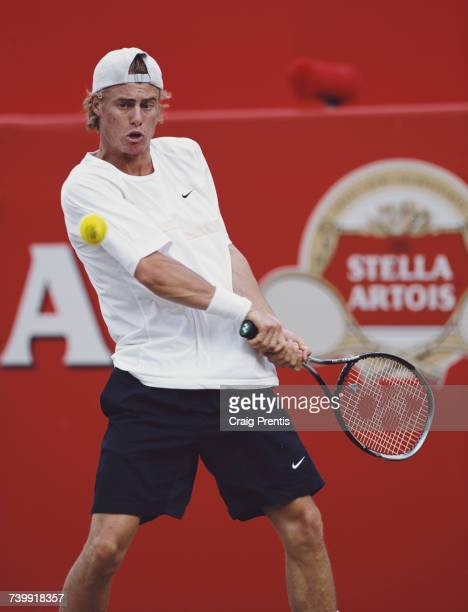 Lleyton Hewitt of Australia makes a double backhand return on his way to victory over Byron Black of Zimbabwe during their Men's Singles third round...