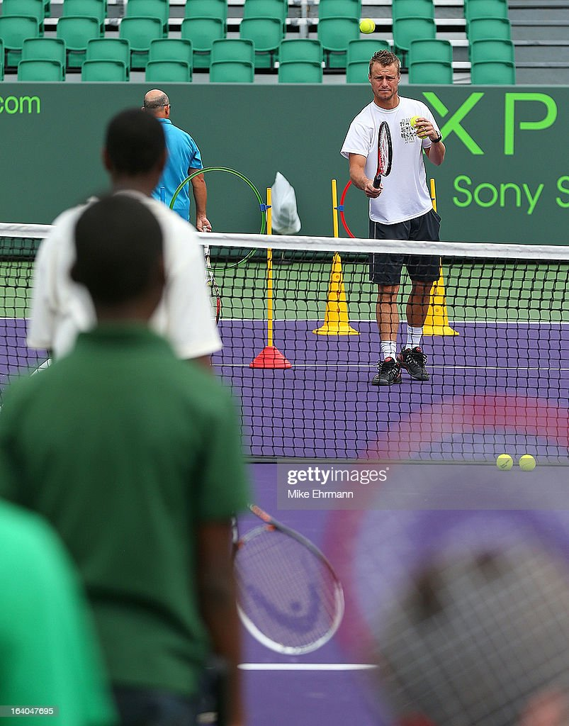 Lleyton Hewitt of Australia participates in Lindt Kids' Day during Day 2 of the Sony Open at Crandon Park Tennis Center on March 19, 2013 in Key Biscayne, Florida.