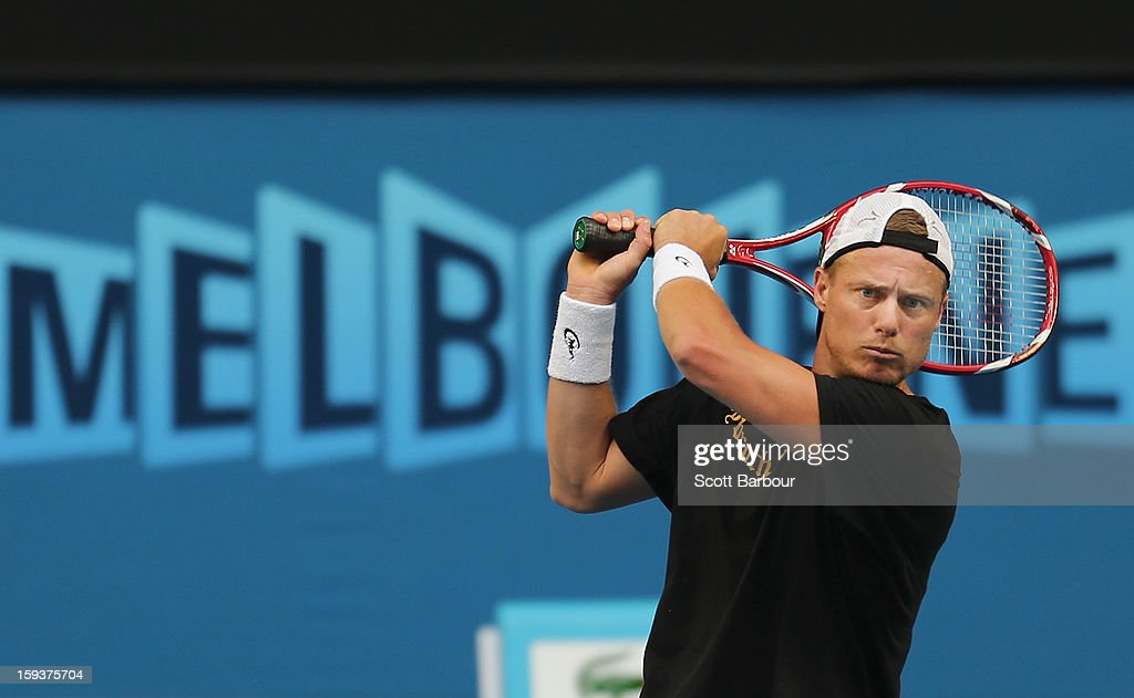 Lleyton Hewitt of Australia plays a backhand during a practice session ahead of the 2013 Australian Open at Melbourne Park on January 13, 2013 in Melbourne, Australia.