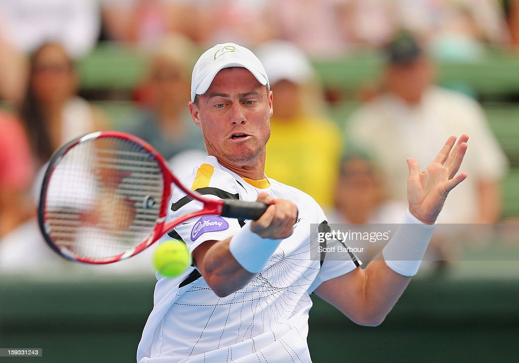 <a gi-track='captionPersonalityLinkClicked' href=/galleries/search?phrase=Lleyton+Hewitt&family=editorial&specificpeople=167178 ng-click='$event.stopPropagation()'>Lleyton Hewitt</a> of Australia plays a backhand during his match against Juan Martín del Potro of Argentina during day four of the AAMI Classic at Kooyong on January 12, 2013 in Melbourne, Australia.