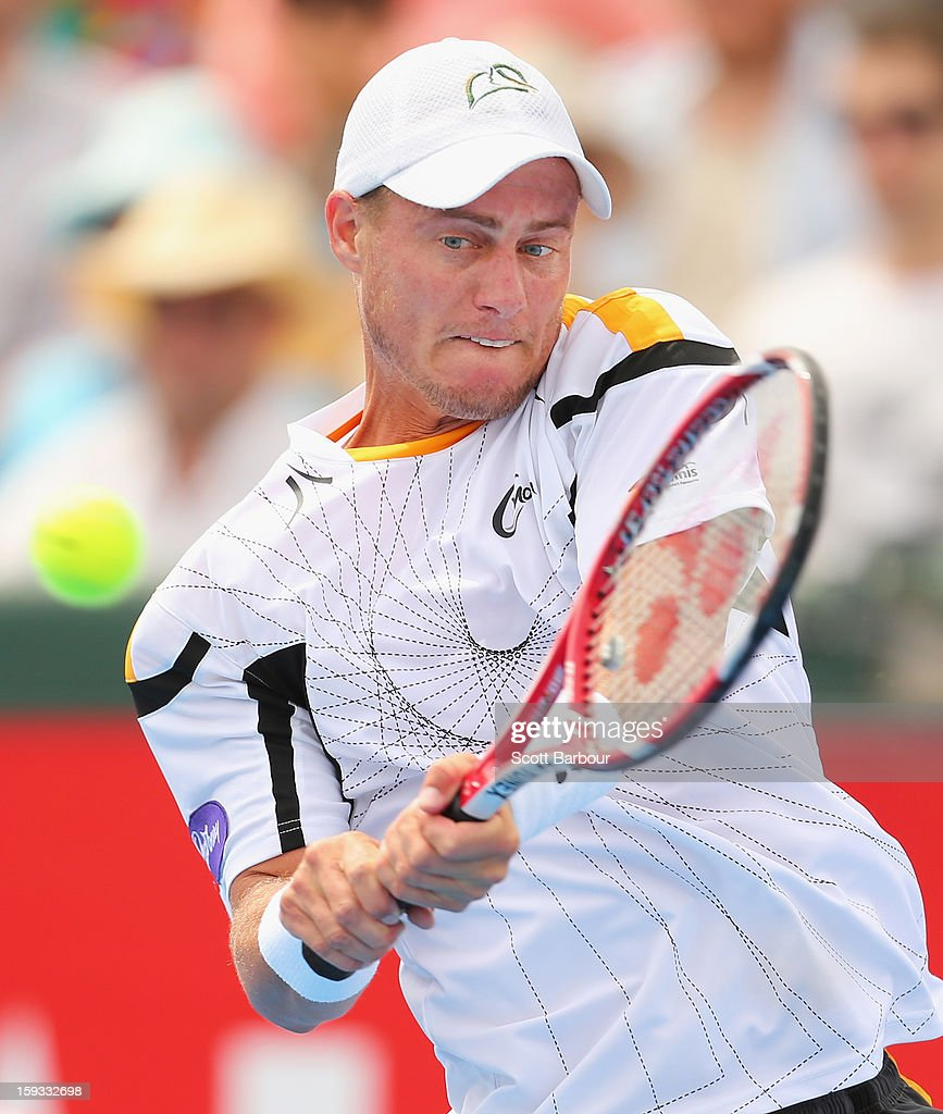 Lleyton Hewitt of Australia plays a backhand during his match against Juan Martín del Potro of Argentina during day four of the AAMI Classic at Kooyong on January 12, 2013 in Melbourne, Australia.