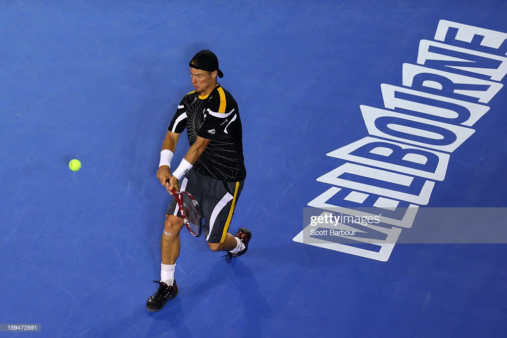 Lleyton Hewitt of Australia plays a backhand in his first round match against Janko Tipsarevic of Serbia during day one of the 2013 Australian Open at Melbourne Park on January 14, 2013 in Melbourne, Australia.