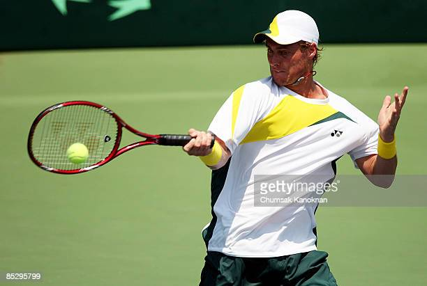 Lleyton Hewitt of Australia plays a forehand against Danai Udomchoke of Thailand during day three of the Davis Cup Asia/Oceania Group I second round...
