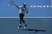 Lleyton Hewitt of Australia plays a forehand during his match against Gael Monfils of France during day four of the AAMI Classic at Kooyong on...