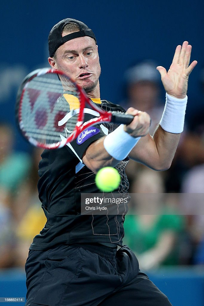 <a gi-track='captionPersonalityLinkClicked' href=/galleries/search?phrase=Lleyton+Hewitt&family=editorial&specificpeople=167178 ng-click='$event.stopPropagation()'>Lleyton Hewitt</a> of Australia plays a forehand during his match against Igor Kunitsyn of Russia on day three of the Brisbane International at Pat Rafter Arena on January 1, 2013 in Brisbane, Australia.