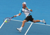 Lleyton Hewitt of Australia plays a forehand during his match against Andy Murray of Great Britain during day three of the AAMI Classic at Kooyong on...