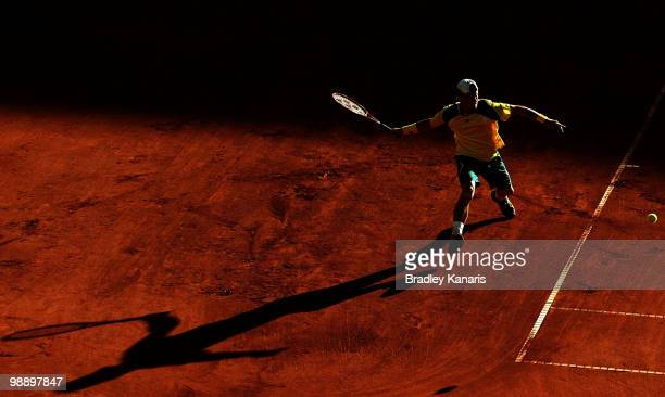 Lleyton Hewitt of Australia plays a forehand during his match against Totsuma Ito of Japan during the match between Australia and Japan on day one of...