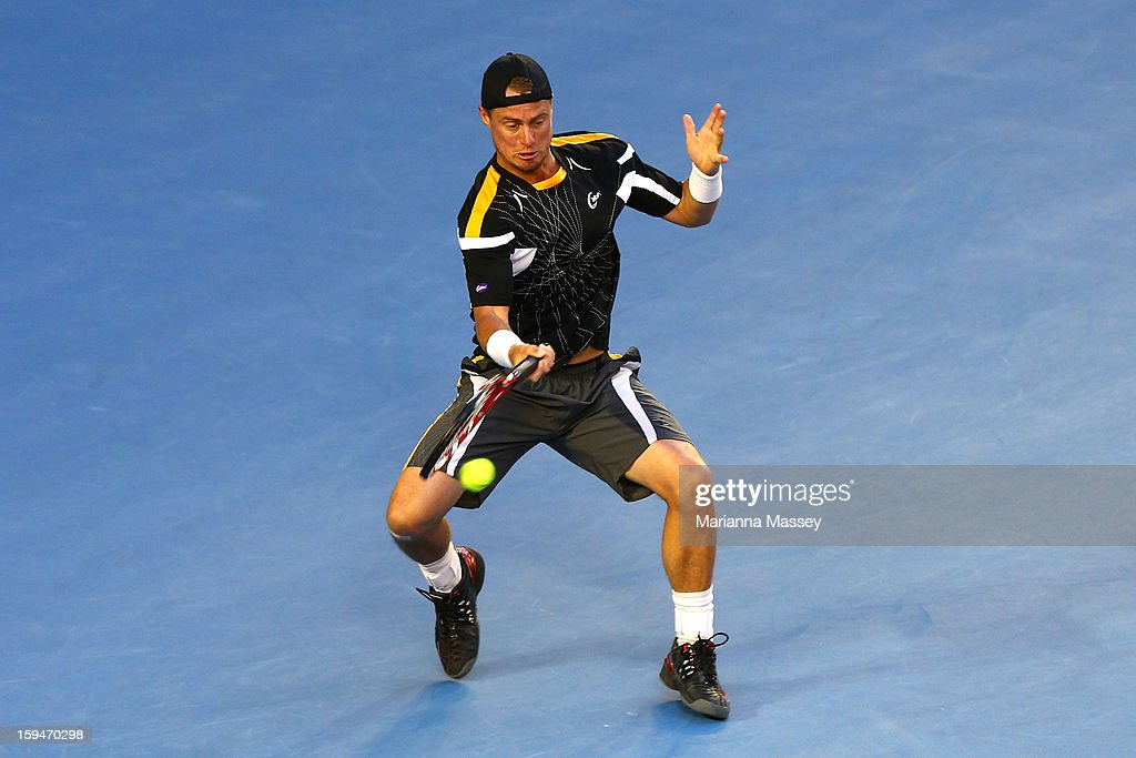 Lleyton Hewitt of Australia plays a forehand in his first round match against Janko Tipsarevic of Serbia during day one of the 2013 Australian Open at Melbourne Park on January 14, 2013 in Melbourne, Australia.