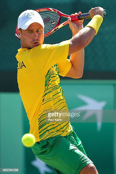 Lleyton Hewitt of Australia plays a return shot to Farrukh Dustov of Uzbekistan in their singles match during the Davis Cup World Group Playoff tie...
