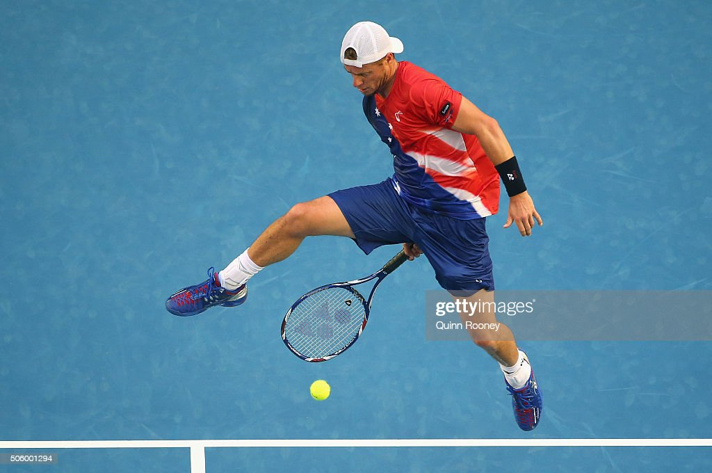 Lleyton Hewitt of Australia plays a shot between his legs in his second round match against David Ferrer of Spain during day four of the 2016 Australian Open at Melbourne Park on January 21, 2016 in Melbourne, Australia.