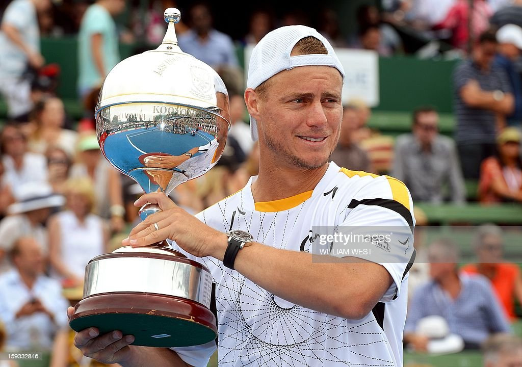 Lleyton Hewitt of Australia poses with the trophy after defeating Juan Martin Del Potro of Argentina in the final of the Kooyong Classic in Melbourne on January 12, 2013. AFP PHOTO/William WEST USE