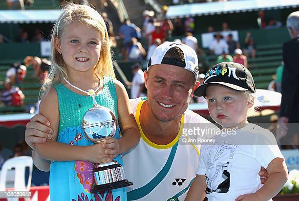 Lleyton Hewitt of Australia poses with the trophy and his kids Mia and Cruz after his match against Gael Monfils of France during day four of the...