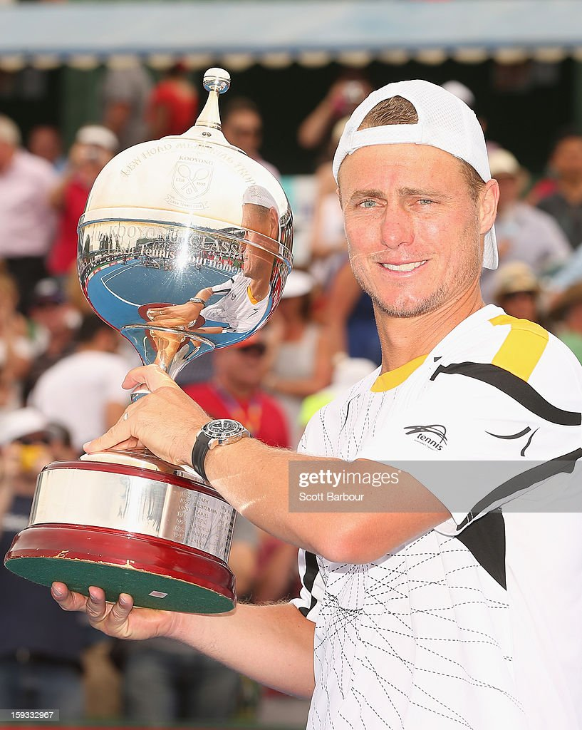 <a gi-track='captionPersonalityLinkClicked' href=/galleries/search?phrase=Lleyton+Hewitt&family=editorial&specificpeople=167178 ng-click='$event.stopPropagation()'>Lleyton Hewitt</a> of Australia poses with the winners trophy after winning his match against Juan Martín del Potro of Argentina during day four of the AAMI Classic at Kooyong on January 12, 2013 in Melbourne, Australia.