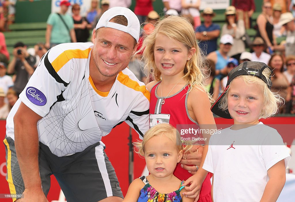 <a gi-track='captionPersonalityLinkClicked' href=/galleries/search?phrase=Lleyton+Hewitt&family=editorial&specificpeople=167178 ng-click='$event.stopPropagation()'>Lleyton Hewitt</a> of Australia poses with the winners trophy and his children Ava Hewitt, Cruz Hewitt and Mia Hewitt after winning his match against Juan Martín del Potro of Argentina during day four of the AAMI Classic at Kooyong on January 12, 2013 in Melbourne, Australia.