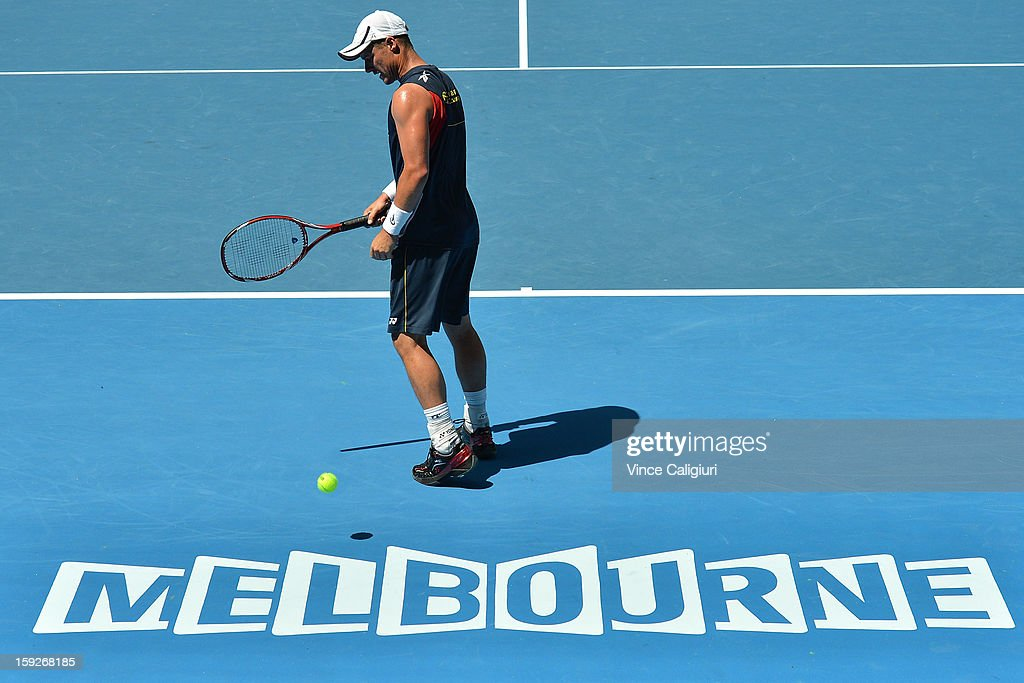 <a gi-track='captionPersonalityLinkClicked' href=/galleries/search?phrase=Lleyton+Hewitt&family=editorial&specificpeople=167178 ng-click='$event.stopPropagation()'>Lleyton Hewitt</a> of Australia prepares to serve during practice ahead of the 2013 Australian Open at Melbourne Park on January 11, 2013 in Melbourne, Australia.