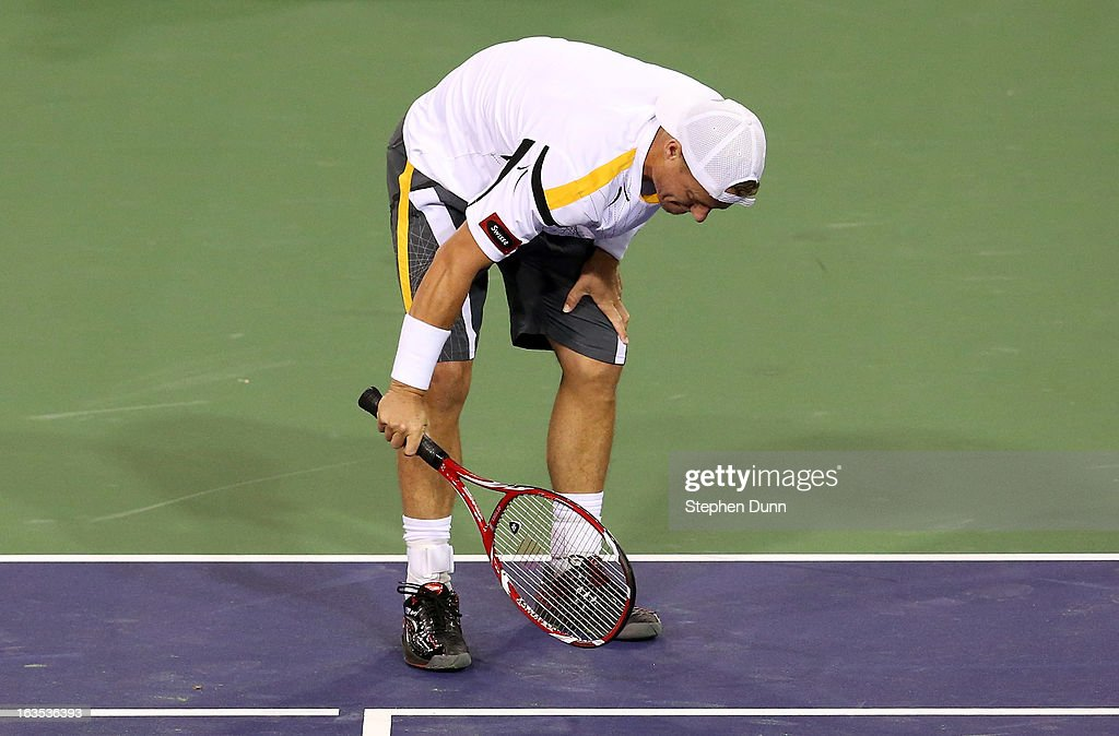 Lleyton Hewitt of Australia questions the challenge camera system's upholding a challenge by Stanislas Wawrinka of Switzerland during day 6 of the BNP Paribas Open at Indian Wells Tennis Garden on March 11, 2013 in Indian Wells, California. (Photo by Stephen Dunn/Getty Images).