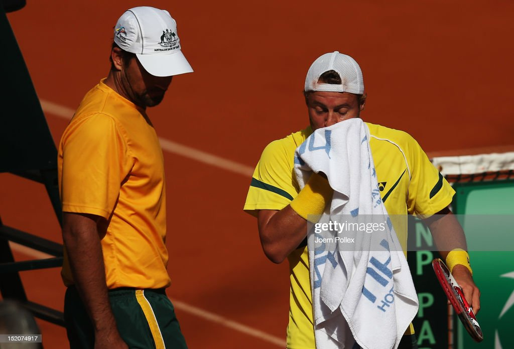 <a gi-track='captionPersonalityLinkClicked' href=/galleries/search?phrase=Lleyton+Hewitt&family=editorial&specificpeople=167178 ng-click='$event.stopPropagation()'>Lleyton Hewitt</a> (R) of Australia reacts during his match against Cedrik-Marcel Stebe of Germany during the Davis Cup World Group Play-Off match between Germany and Australia at Rothenbaum on September 16, 2012 in Hamburg, Germany.