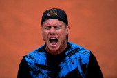 Lleyton Hewitt of Australia reacts during his men's singles match against Carlos Berlocq of Argentina on day three of the French Open at Roland...