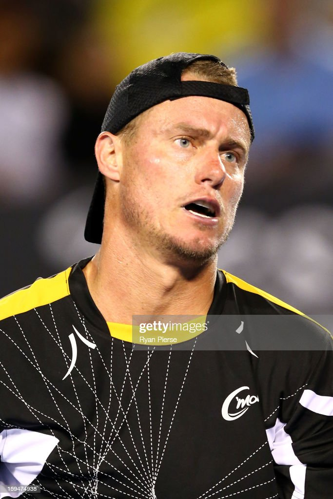 Lleyton Hewitt of Australia reacts in his first round match against Janko Tipsarevic of Serbia during day one of the 2013 Australian Open at Melbourne Park on January 14, 2013 in Melbourne, Australia.