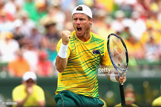 Lleyton Hewitt of Australia reacts in Men's doubles match against Mike Bryan and Bob Bryan of the United States during the Davis Cup tie between...