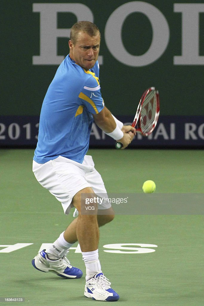 Lleyton Hewitt of Australia returns a ball to Andreas Seppi of Italy on day two of the Shanghai Rolex Masters at the Qi Zhong Tennis Center on October 8, 2013 in Shanghai, China.