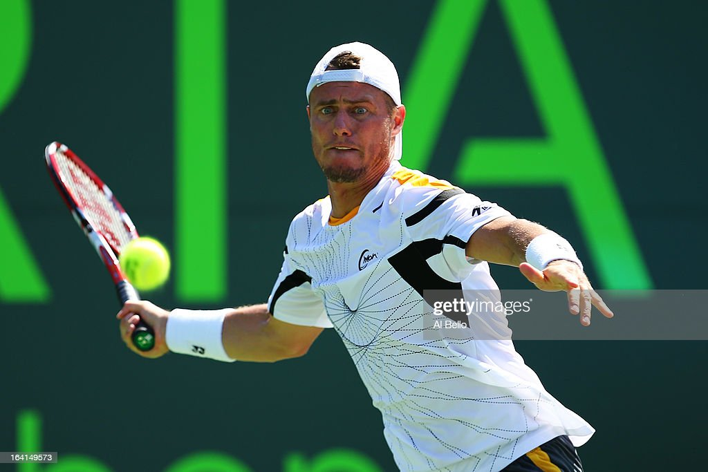 Lleyton Hewitt of Australia returns a shot against Joao Sousa of Portugal during Day 3 of the Sony Open at at the Crandon Park Tennis Center on March 20, 2013 in Key Biscayne, Florida.