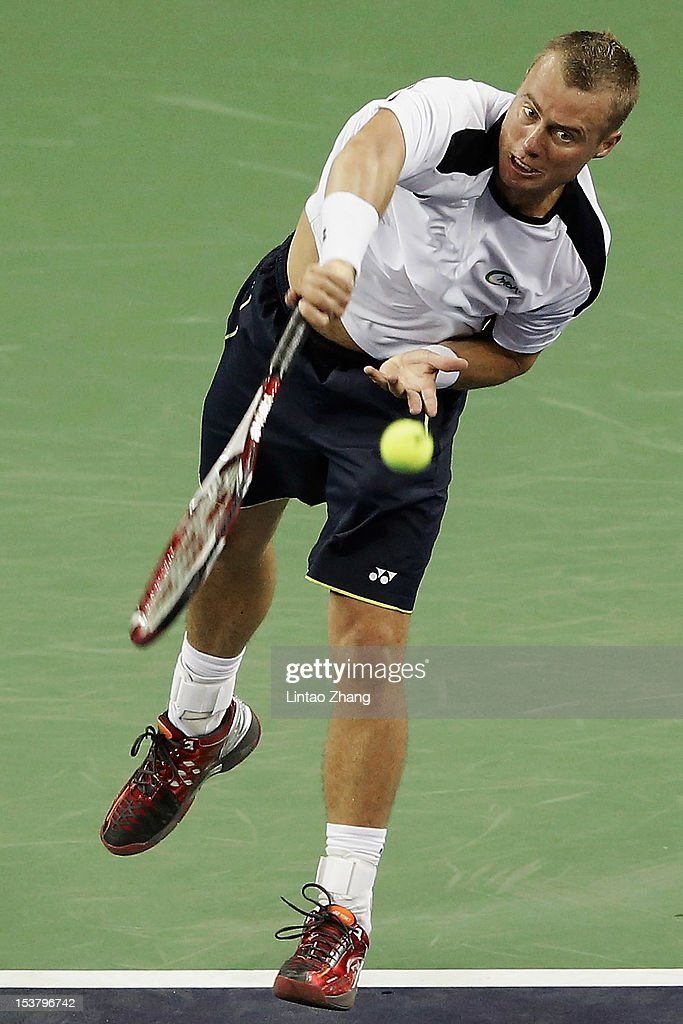 Lleyton Hewitt of Australia returns a shot to Radek Stepanek of Czech Republic during day three of Shanghai Rolex Masters at the Qi Zhong Tennis Center on October 9, 2012 in Shanghai, China.