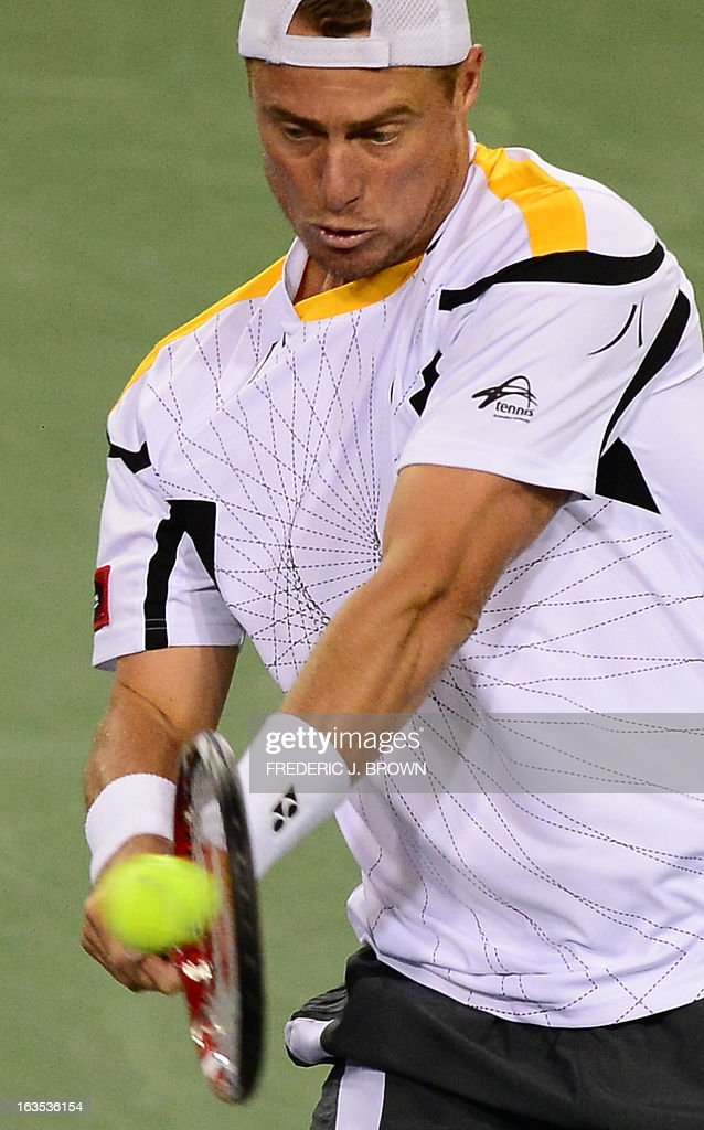 Lleyton Hewitt of Australia returns against Stanislas Wawrinka of Switzerland during their WTA third round match at the BNP Paribas Open in Indian Wells, California on March 11, 2013. AFP PHOTO / Frederic J. BROWN