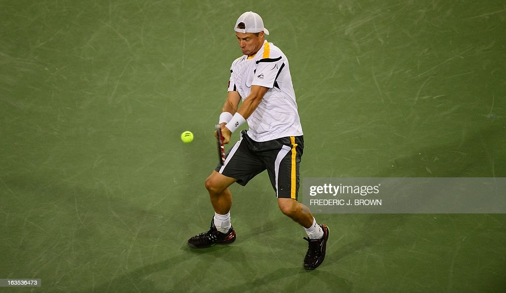 Lleyton Hewitt of Australia returns against Stanislas Wawrinka of Switzerland during their WTA third round match at the BNP Paribas Open in Indian Wells, California on March 11, 2013. AFP PHOTO/Frederic J. BROWN