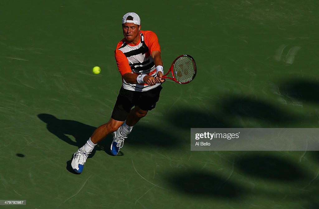 Lleyton Hewitt of Australia returns the ball to Robin Haase of the Netherlands uring their match on day 4 of the Sony Open at Crandon Park Tennis Center on March 20, 2014 in Key Biscayne, Florida.