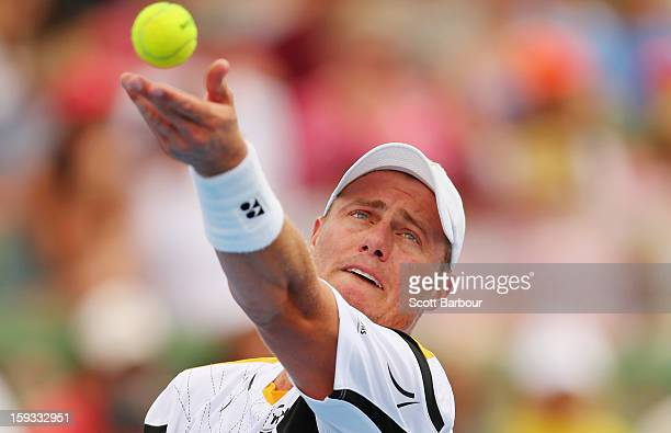 Lleyton Hewitt of Australia serves during his match against Juan Martín del Potro of Argentina during day four of the AAMI Classic at Kooyong on...