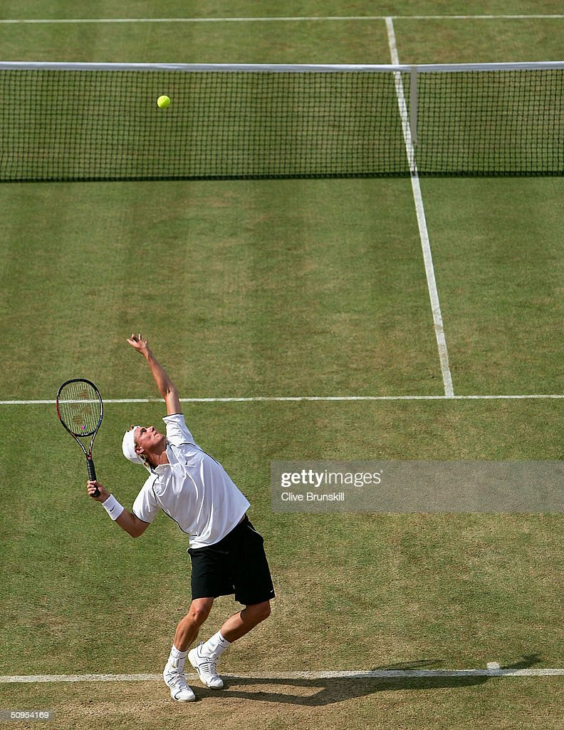 Lleyton Hewitt of Australia serves during his semi-final match against Andy Roddick of the U.S. at the Stella Artois Tennis Championships at the Queen?s Club June 12, 2004 in London, England.
