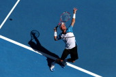 Lleyton Hewitt of Australia serves in his first round match against Andreas Seppi of Italy during day two of the 2014 Australian Open at Melbourne...
