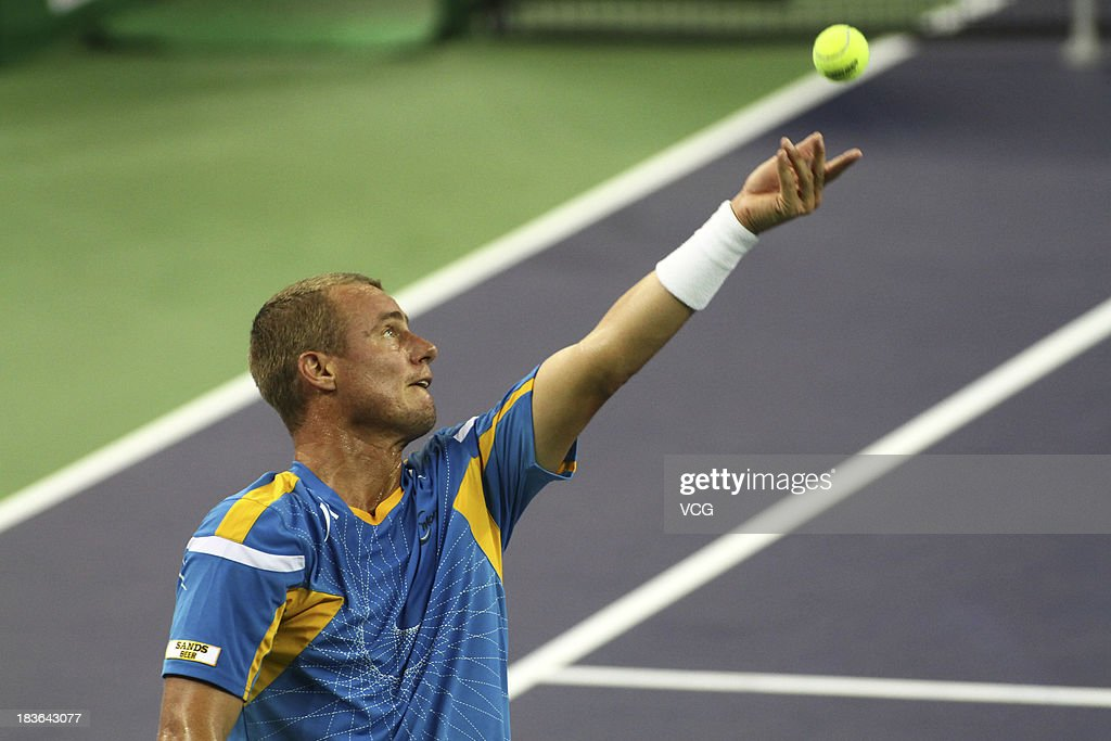 Lleyton Hewitt of Australia serves to Andreas Seppi of Italy on day two of the Shanghai Rolex Masters at the Qi Zhong Tennis Center on October 8, 2013 in Shanghai, China.
