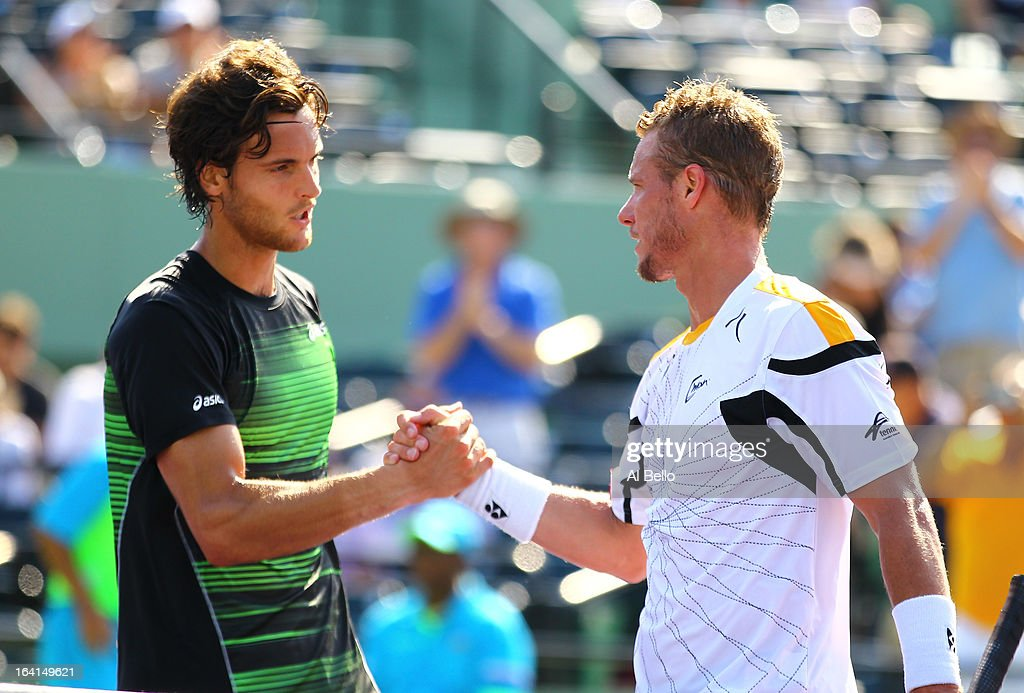Lleyton Hewitt of Australia shakes hands with Joao Sousa of Portugal after winning his match during Day 3 of the Sony Open at at the Crandon Park Tennis Center on March 20, 2013 in Key Biscayne, Florida.