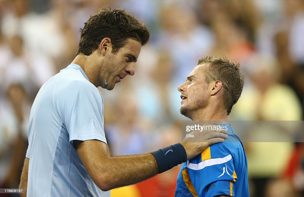 Lleyton Hewitt of Australia shakes hands with Juan Martin Del Potro of Argentina after defeating him during their round match on Day Five of the 2013 US Open at USTA Billie Jean King National Tennis Center on August 30, 2013 in the Flushing neighborhood of the Queens borough of New York City.
