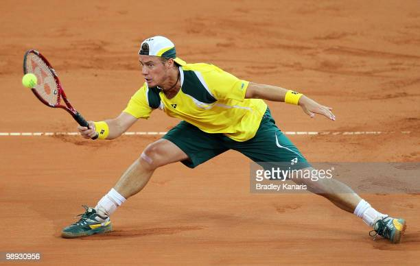 Lleyton Hewitt of Australia stretches out to play a forehand during his match against Yuichi Sugita of Japan during the match between Australia and...
