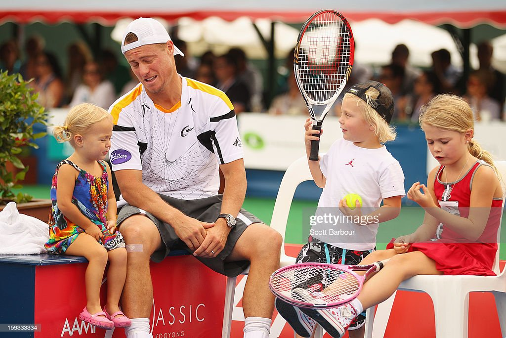 <a gi-track='captionPersonalityLinkClicked' href=/galleries/search?phrase=Lleyton+Hewitt&family=editorial&specificpeople=167178 ng-click='$event.stopPropagation()'>Lleyton Hewitt</a> of Australia talks with his children Ava Hewitt, Cruz Hewitt and <a gi-track='captionPersonalityLinkClicked' href=/galleries/search?phrase=Mia+Hewitt&family=editorial&specificpeople=560159 ng-click='$event.stopPropagation()'>Mia Hewitt</a> after winning his match against Juan Martín del Potro of Argentina during day four of the AAMI Classic at Kooyong on January 12, 2013 in Melbourne, Australia.