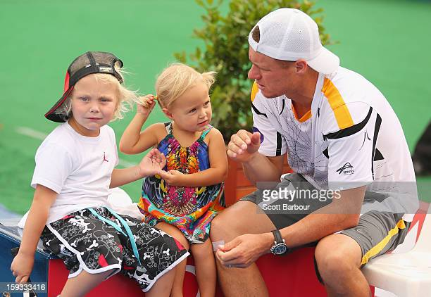 Lleyton Hewitt of Australia talks with his children Ava Hewitt Cruz Hewitt and Mia Hewitt after winning his match against Juan Martín del Potro of...