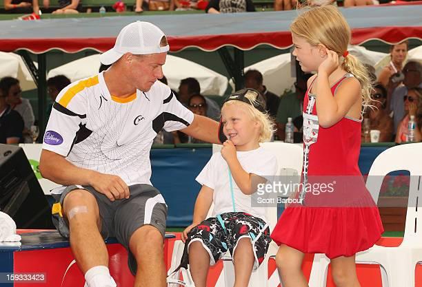 Lleyton Hewitt of Australia talks with his children Ava Hewitt Cruz Hewitt and Mia Hewitt after winning his match against Juan Martín del Potro of...