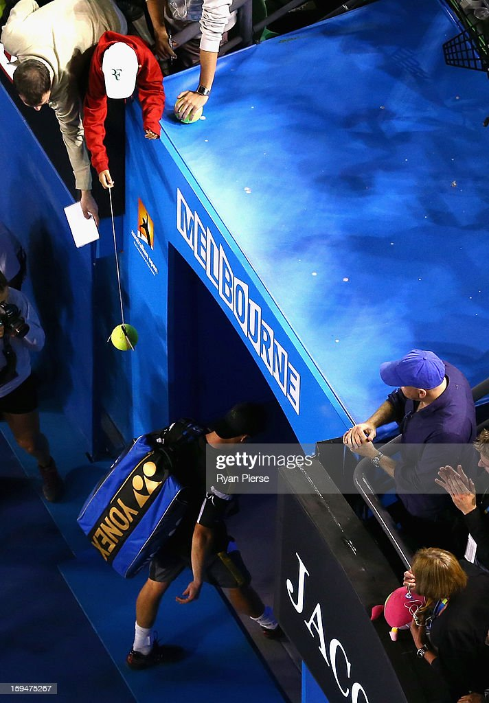Lleyton Hewitt of Australia walks from the court after losing his first round match against Janko Tipsarevic of Serbia during day one of the 2013 Australian Open at Melbourne Park on January 14, 2013 in Melbourne, Australia.